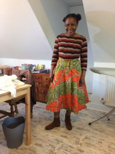 Patience wearing African print skirt